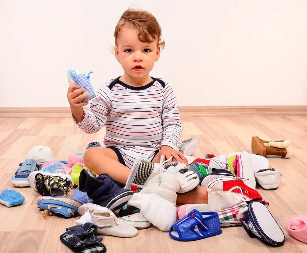 Child sitting in clutter