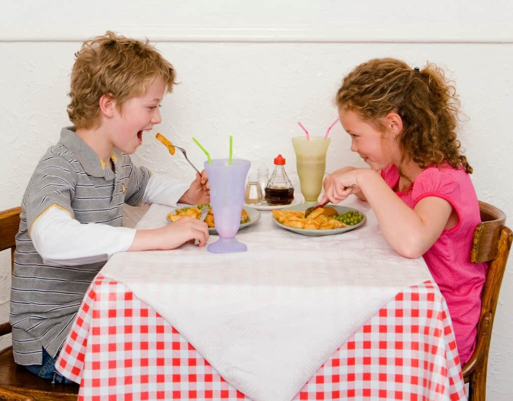 Children eating out at a restaurant.