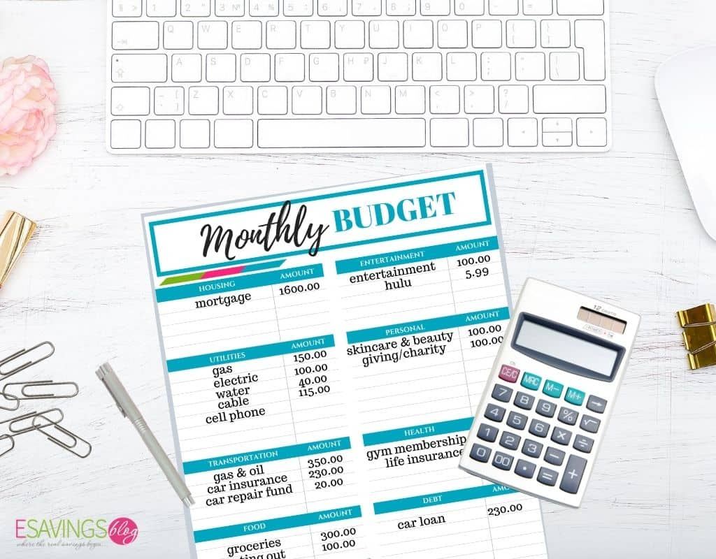 Monthly Budget Printable Being FIlled out on a Desk